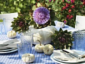 Autumn table decorations: artichokes and pumpkins