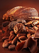 Chocolates, cocoa beans, chocolate rolls and cacao fruits