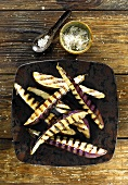 Grilled aubergines with spiced salt (overhead view)