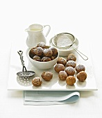 Sweet dough balls with icing sugar