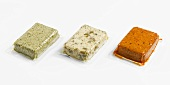 Three types of vacuum-packed tofu: basil, olive, rosso
