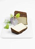 Smoked tofu, a slice cut, red onion & oregano on porcelain slab