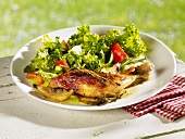 Lemon chicken with salad leaves