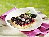 Piece of blackberry cake on plate