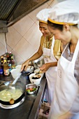 Thai women cooking