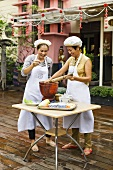 Thai women cooking on terrace