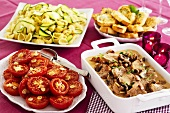Christmas meal: pork & mushroom ragout, tomatoes, garlic bread, pasta & courgettes
