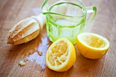 Squeezed lemon, lemon juice and wooden lemon reamer