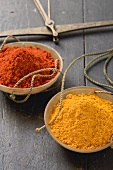 Curry powder and chilli powder in scale pans