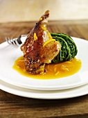 Duck with orange sauce and stuffed savoy cabbage leaf