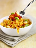 Ribbon pasta with tomato sauce and soya beans