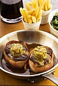 Beef medallions with Parisian butter, chips