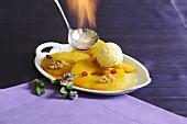 Flambéed pineapple with vanilla ice cream