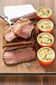 Roast beef with courgette gratin