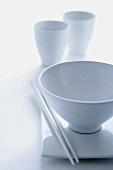 White food bowl, beakers and chopsticks
