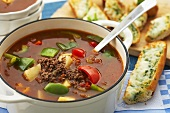 Goulash soup and baguette with toasted mozzarella