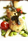 Crab cakes with seaweed and vegetables
