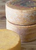 Several whole hard cheeses
