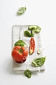 Vegetables, basil and salt on fabric napkin