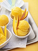 Several portions of mango ice cream on a tray