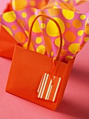 Orange gift bag and wrapping paper