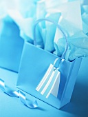 Blue gift bag and wrapping paper