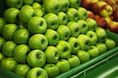 Green apples on a market stall