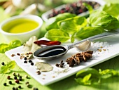 Spices, balsamic vinegar, basil and olive oil