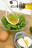 Sprinkling corn salad with olive oil