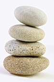 Four pebbles, stacked