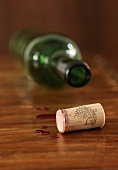 Wine cork and empty wine bottle