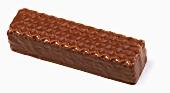 Chocolate-coated wafer on white background