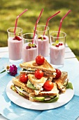 Triangular toast sandwiches with cocktail tomatoes & berry shakes