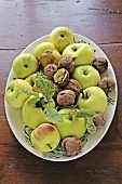 Organic apples and walnuts on plate