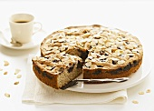 Plum and almond cake with coffee
