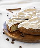 Coffee cake with cinnamon cream, a slice cut