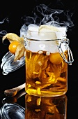 Physalis oil and physalis in preserving jar with dry ice