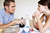 Young couple sitting at breakfast table