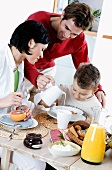 Young family with son having breakfast