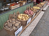 Different varieties of potatoes in baskets at a market