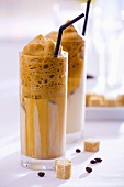 Two glasses of coffee frappé with straws