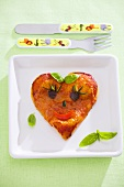 Heart-shaped pizza with amusing face for a child