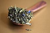 Green tea leaves on wooden spoon