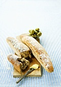 Bread sticks with butter and olives