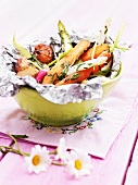 Grilled vegetables on aluminium foil in bowl