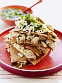 Tortillas with chicken, cheese, spring onions and olives