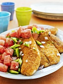 Fish fillets breaded with cornflakes, with vegetable salad
