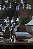 Empty wine glasses and table bell beside place-setting