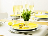 Laid Easter table with glasses of sparkling wine