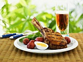 Honey-glazed veal chop with boiled egg and red potatoes